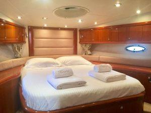 Sunseeker Portofino 53, Express yacht, bedroom, queen size bed, pillows, towels, cupboards