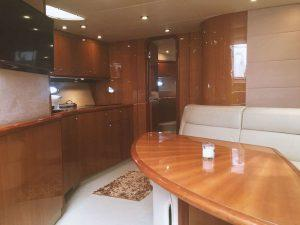 Sunseeker Portofino 53, Express yacht, cabin, kitchen, sink, cupboards, dining table, sofa, flat screen tv