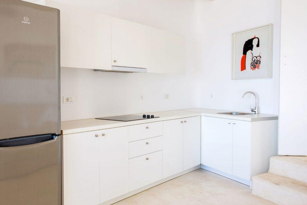 kitchen with white cabins and washstand