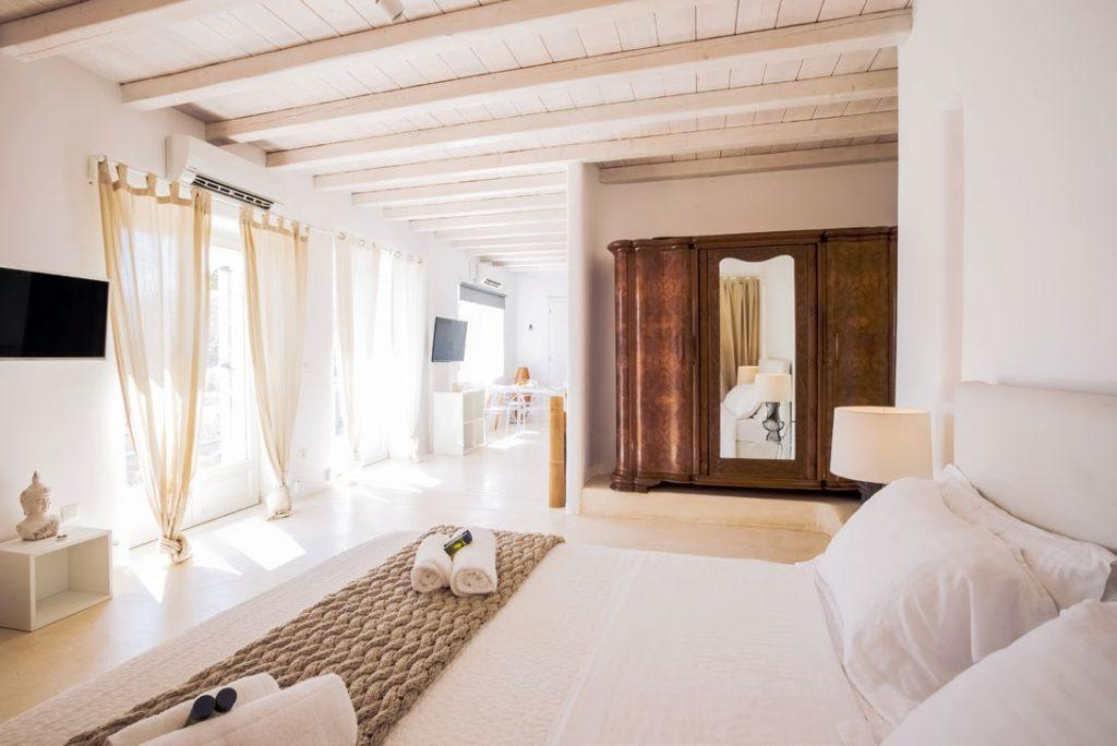 bedroom with old designed wooden cabin and soft towels