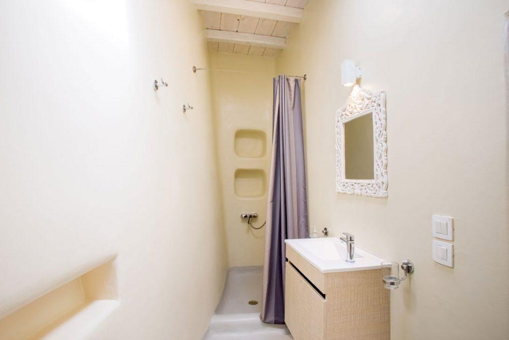 small bathroom with curtains and shower