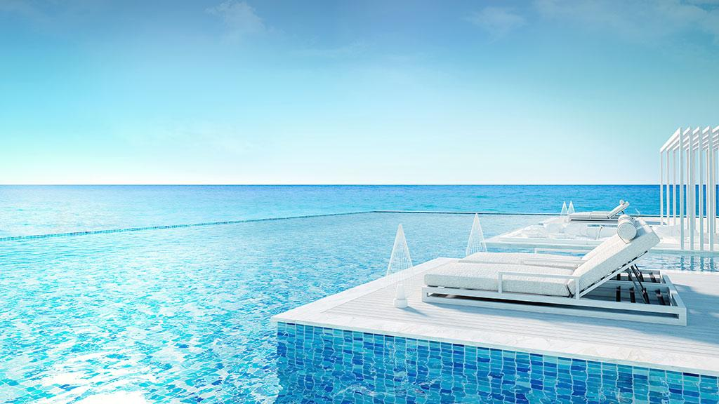 luxury villa pool with sunloungers