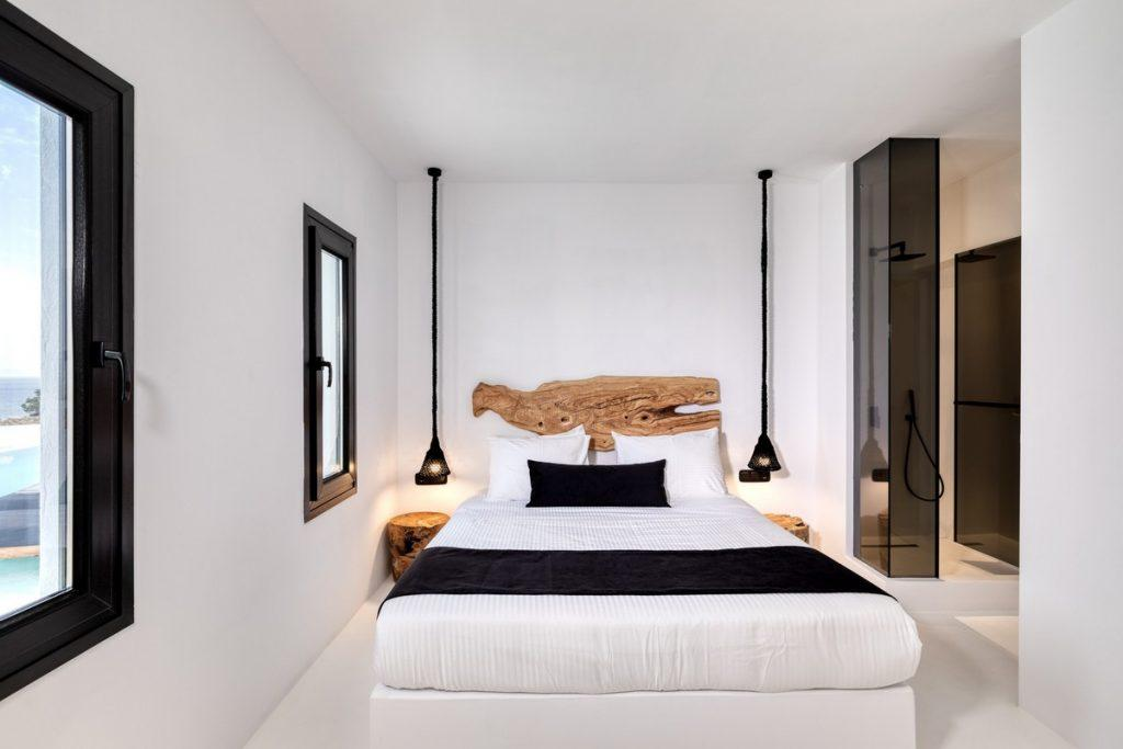 white bedroom containing king size bed two lamp nightstands for good night sleep and battery recharge