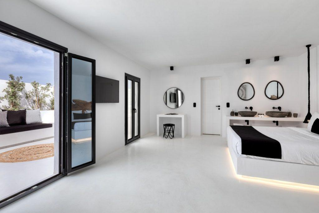 voguishly marble tiled bedroom with balcony exit