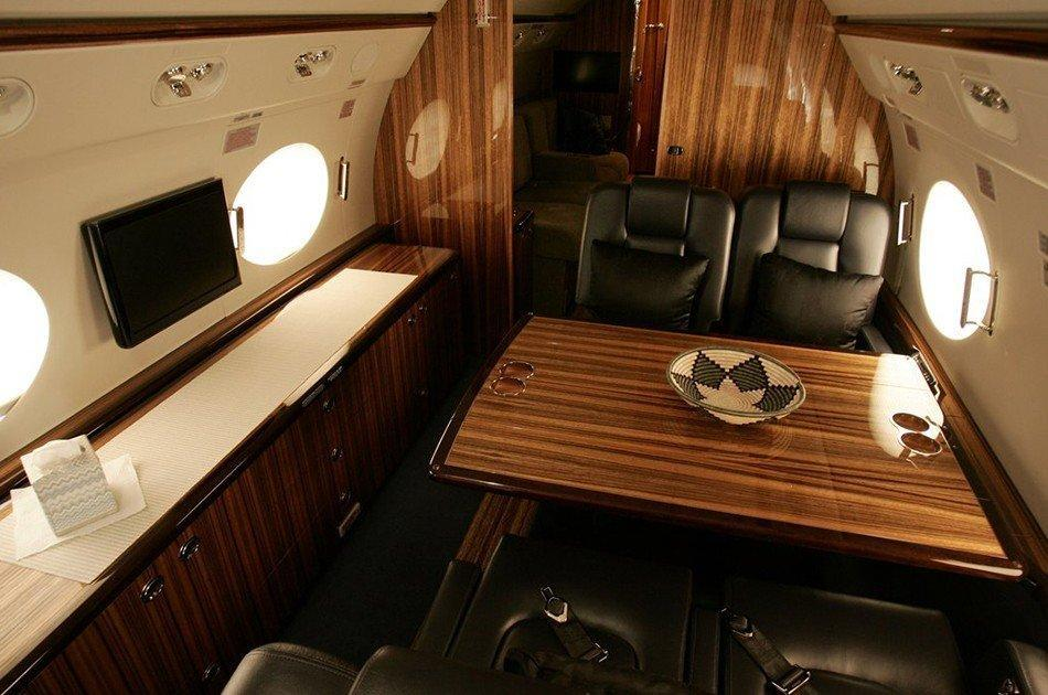 Gulfstream G550 Jet interior, Wooden design, Leather seats, Table, Flat screen tv