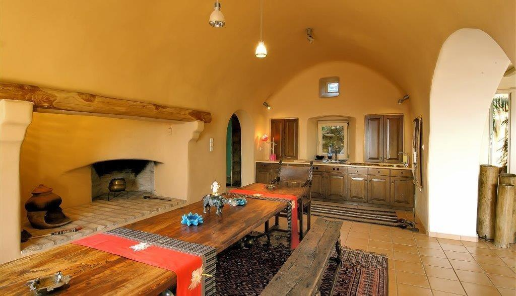 lit dining area with fireplace and old wooden cabins