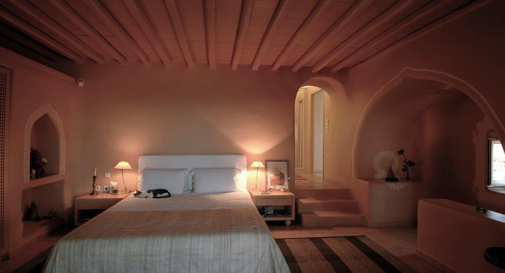 bedroom with dim light providing romantic atmosphere