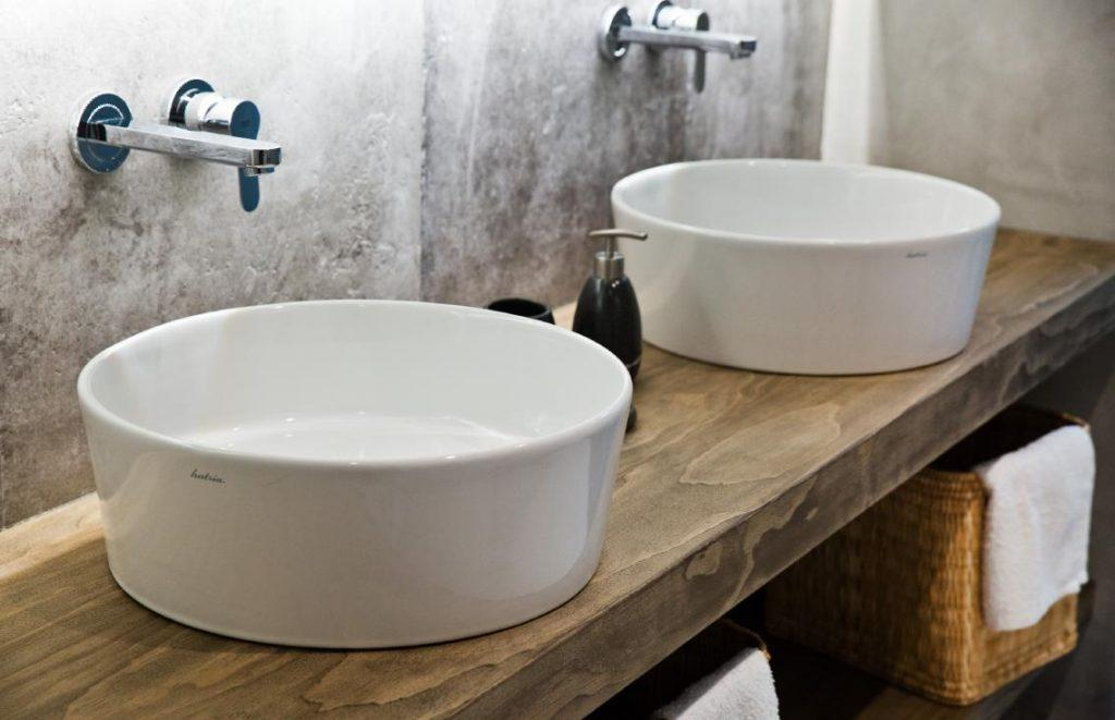bathroom with wooden bench and soft towels