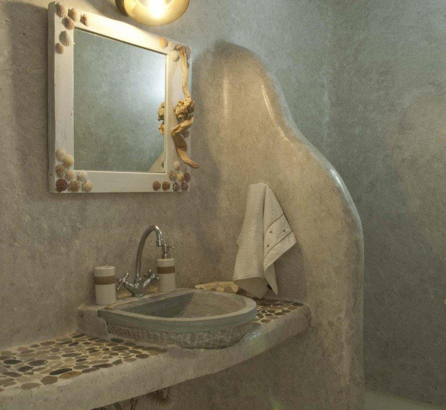 grey wall bathroom with shower and designed mirror