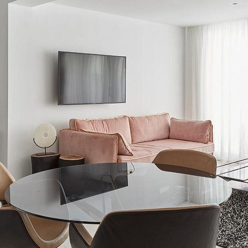 living area with pink soft couch and round table