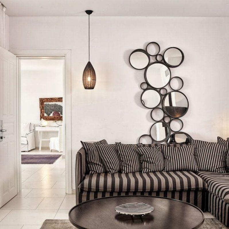white wall living area with soft couch and black round table
