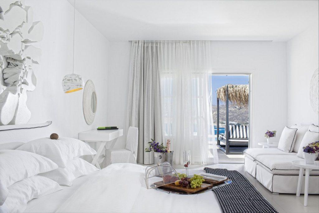 nice designed bedroom with white walls