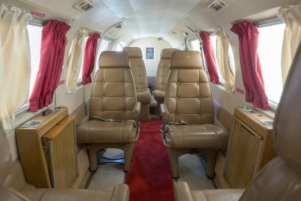 jet with curtains and leather seats