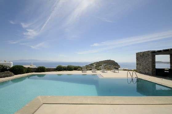 Villa Elizabeth, Aleomandra, Mykonos, swimming pool, sunbeds, stone walls, porch, nature, bushes, panoramic sea view