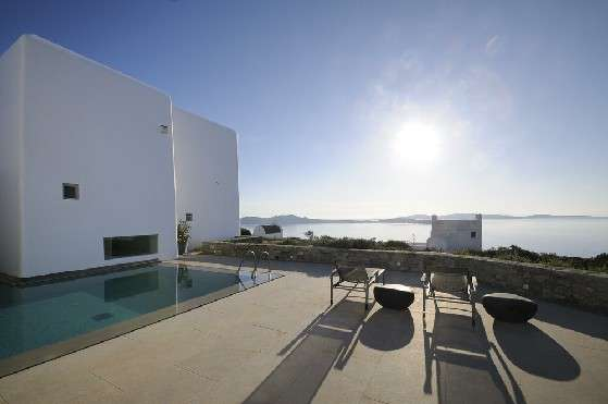 Villa Elizabeth, Aleomandra, Mykonos, exterior, white buildings, swimming pool, sunbeds, stone walls, plants, nature, panoramic sea view