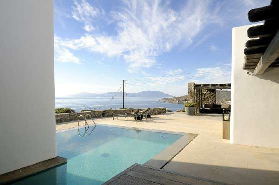 Villa Elizabeth, Aleomandra, Mykonos, outdoor rest area, swimming pool, sunbeds, towels, porch, stone walls, panoramic sea view