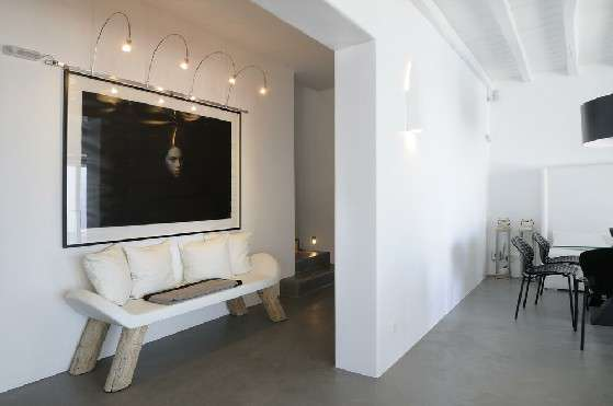 Villa Elizabeth, Aleomandra, Mykonos, lounge, sofa, pillows, painting, decorative lighting, dining table, chairs, stairs, wooden ceiling