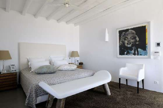 Villa Elizabeth, Aleomandra, Mykonos, bedroom, queen size bed, pillows, painting, armchair, night stand, night table, wooden ceiling, bench
