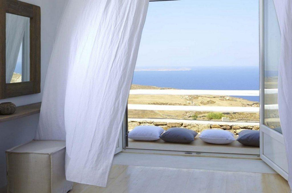white wall bedroom with daylight and beautiful sea view