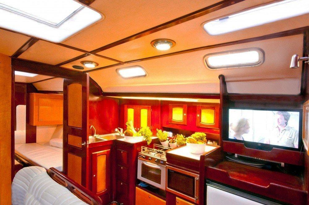fully equipped kitchen with plasma tv