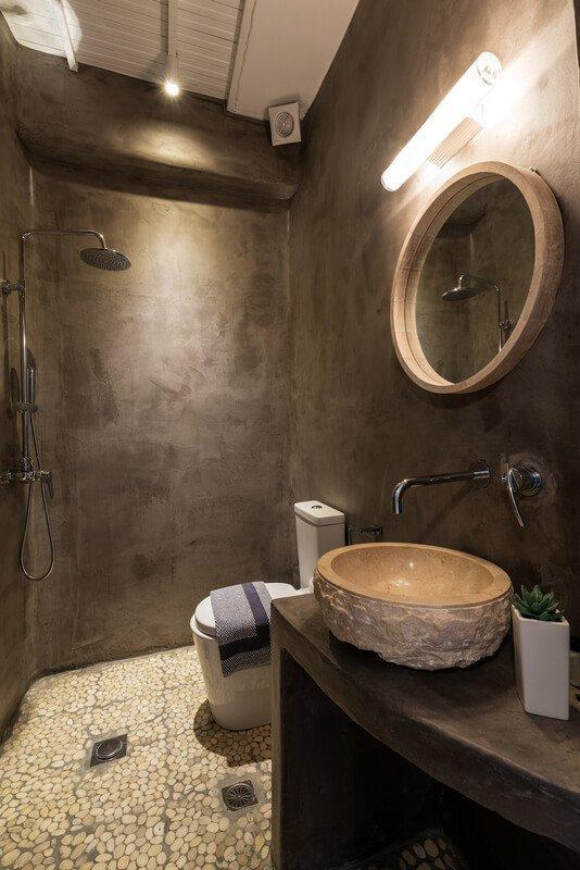 bathroom with wall lamp and shower