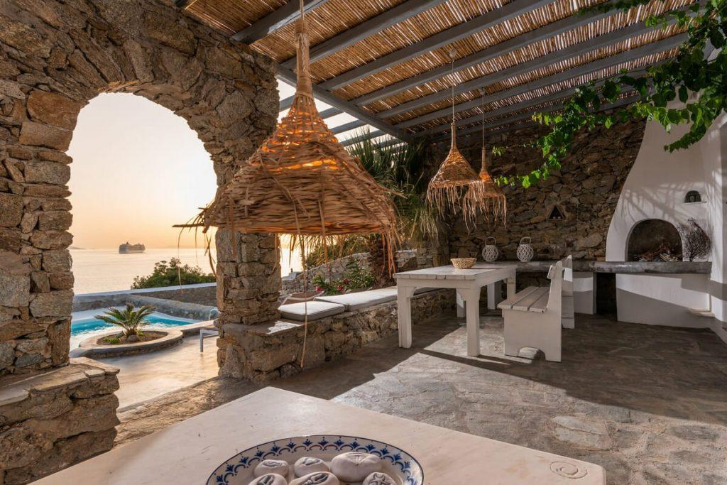 outdoor area with unique designed lamps and wooden table