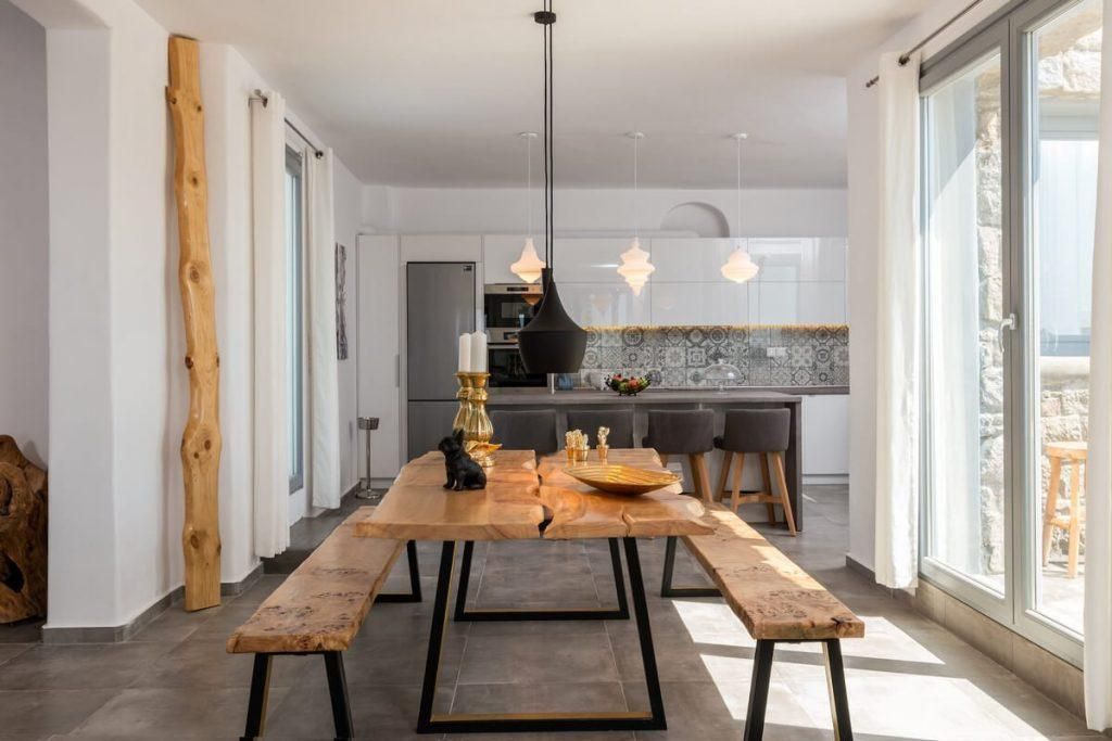 dining area with black lamps and wooden bench