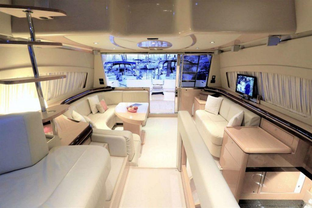 Ferretti 55 Interior 3rd Cabin, table, bed, pillows, shelf, flat screen tv, windows, curtains