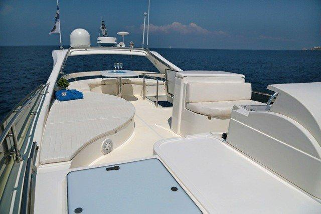Ferretti 55 Exterior, deck, towels, glasses, bed, flowers, sea, horizon, sky