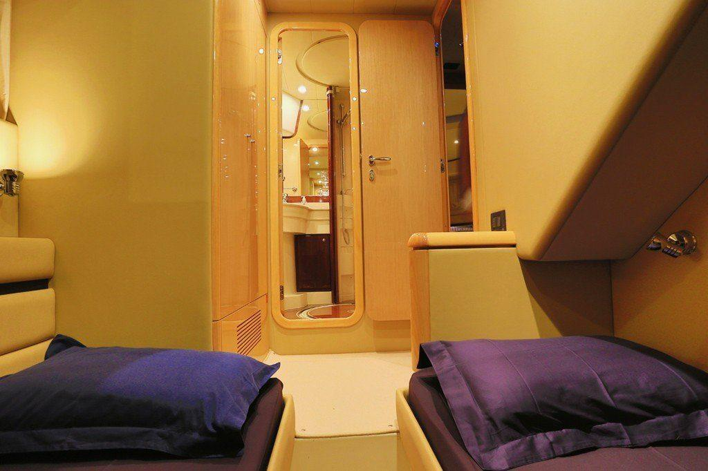 Ferretti 55 Interior 2nd Cabin, bed, pillows, shower, doors, carpet, cabinet, lamp