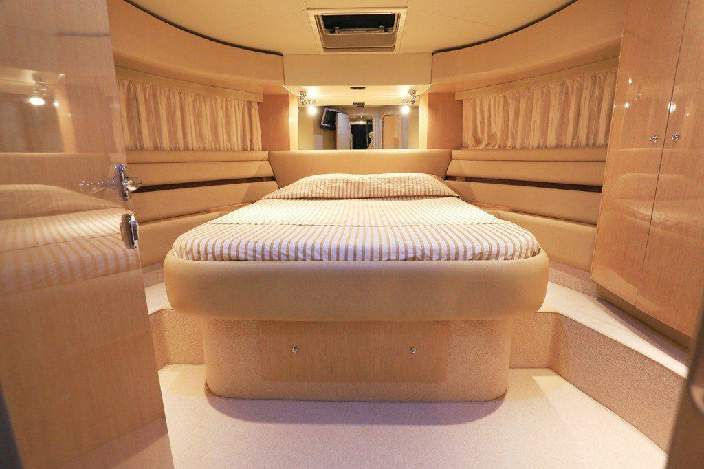 Ferretti 55 Interior 1st Cabin, double bed, pillows, cabinet, doors, lamp, curtains