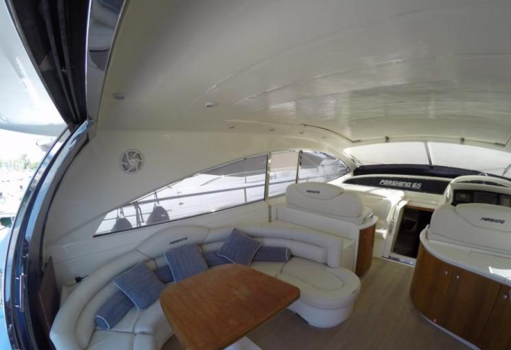 Pershing 65, Express, cockpit, sofa, pillows, table