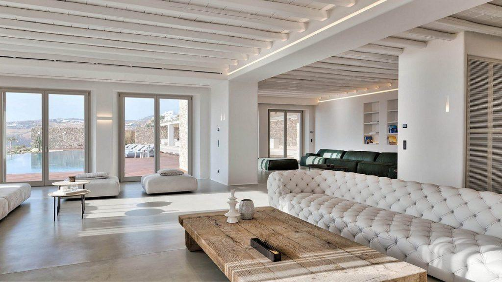 Villa Aphrodite, Agia Sofia, Mykonos, white lounge, wooden table, balcony doors, wooden ceiling