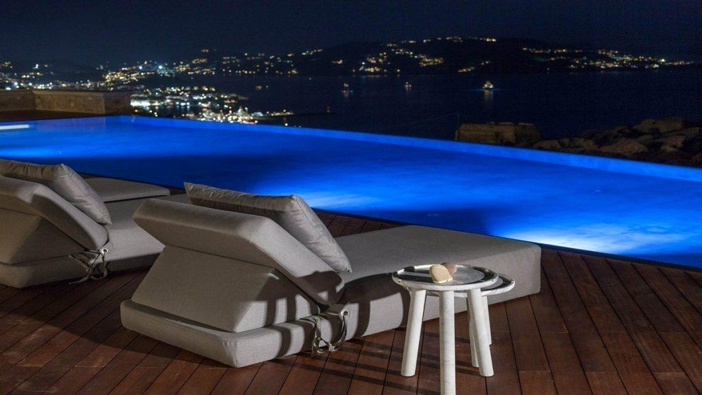 Villa Aphrodite, Agia Sofia, Mykonos, night view, swimming pool, sunbeds, coffee table, panoramic sea view, city view