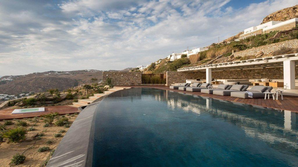 Villa Aphrodite, Agia Sofia, Mykonos, outdoor rest area, swimming pool, sunbeds, stone walls, jacuzzi, nature
