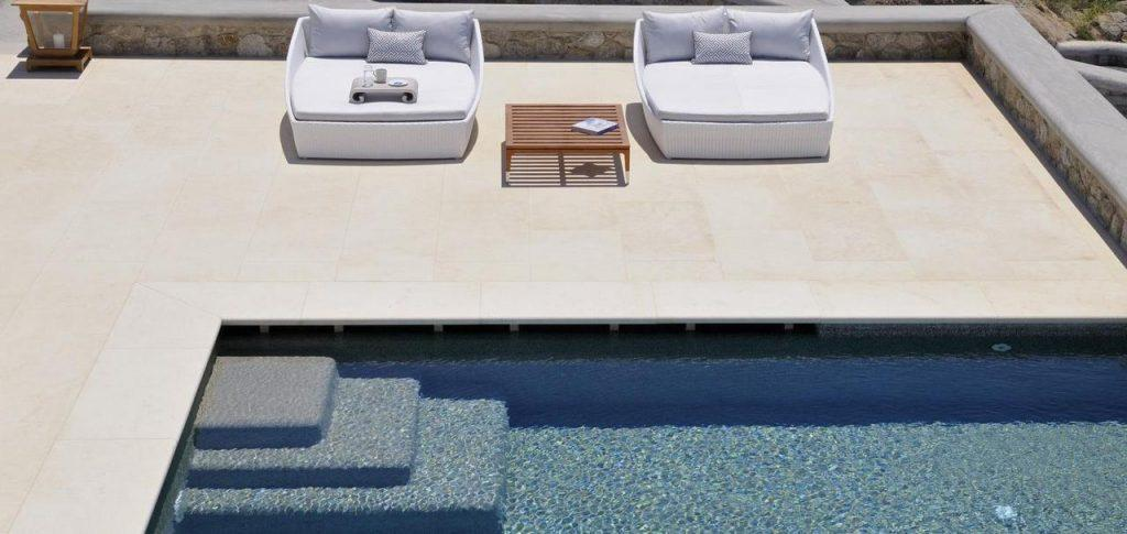 pool outdoor area with two extra comfortable sunbeds and wooden table