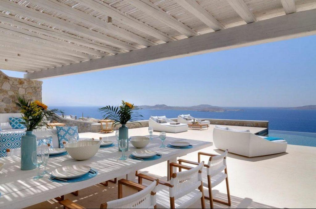 inner part of terrace with enough chairs for all villa quests to sit over the table