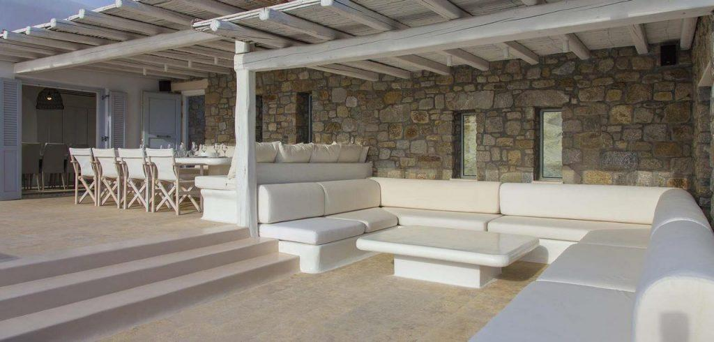 stone walls with a white wooden canopy that provides shade to enjoy