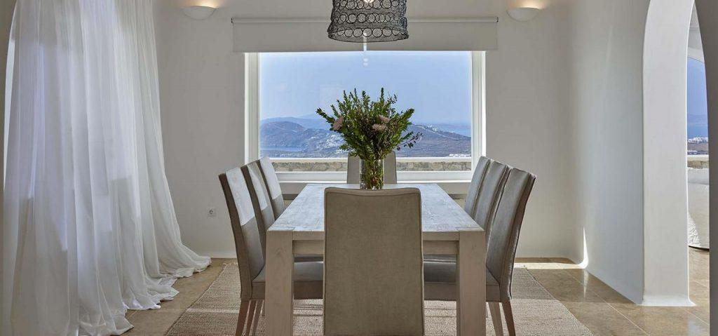modern dining room with lots of daylight and decorative flowers