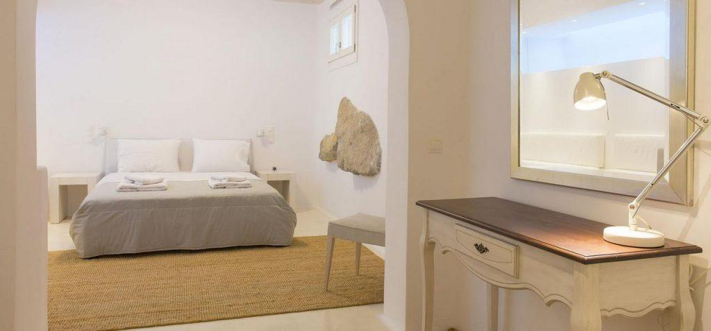 bedroom with white walls and comfortable bed ideal for two