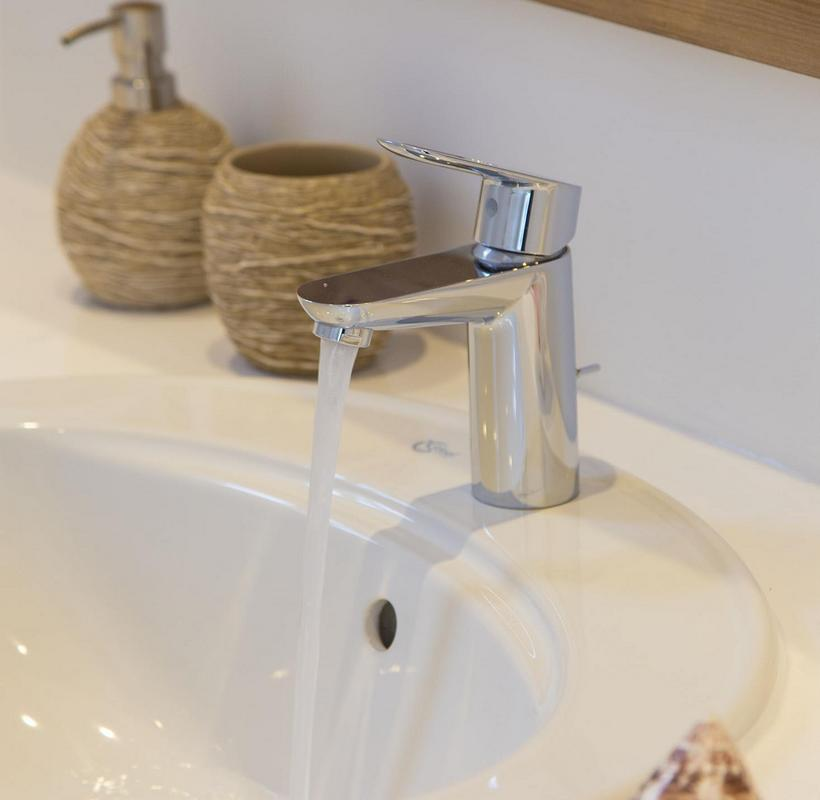 white sink with decorative details