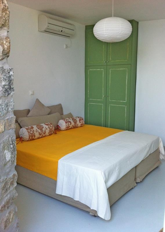 bedroom with green wooden climber and air condition