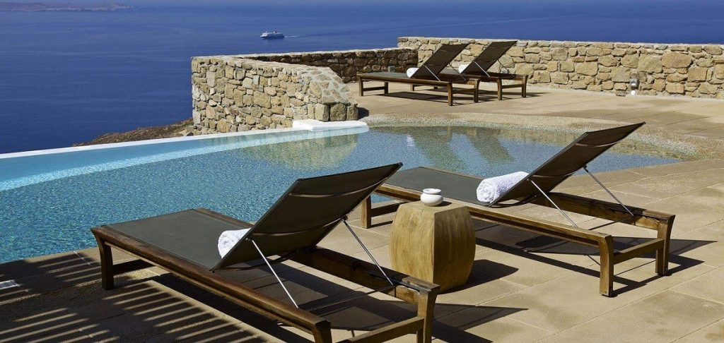 Villa Aegean Gold Houlakia Mykonos sun beds, coffee table, towels, swimming pool, sea view