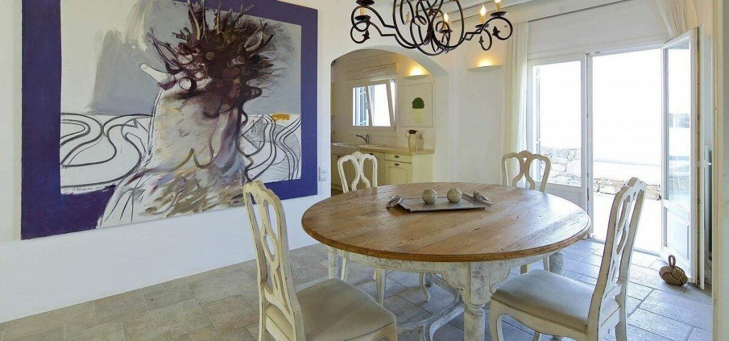Villa Aegean Gold Houlakia Mykonos dining room, painting on the wall