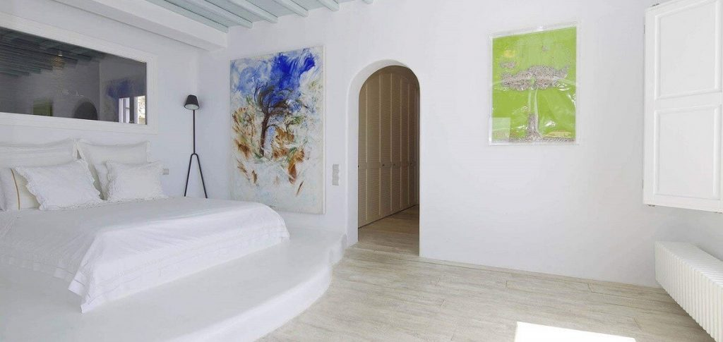 Villa Aegean Gold Houlakia Mykonos 1st bedroom paintings on the wall