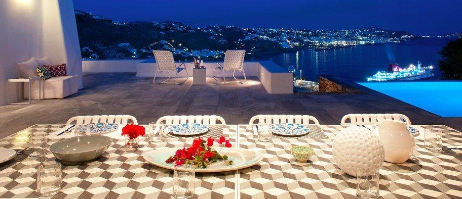 Grand House Villa Tourlos Mykonos Panoramic view at the night, outdoor dining area