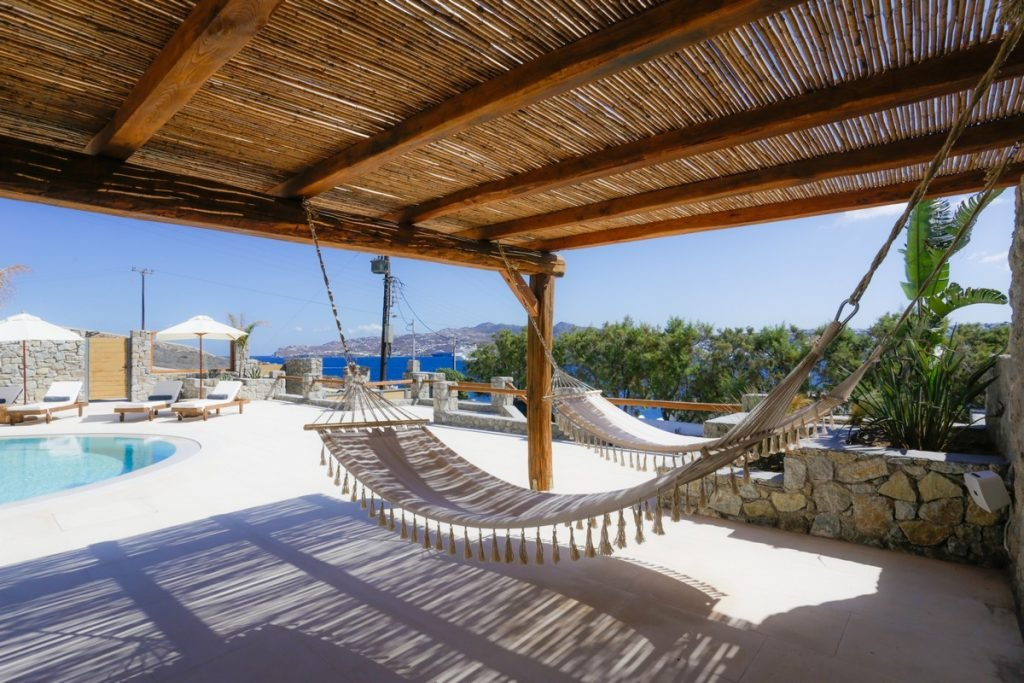 Villa Angelica Kanalia Mykonos outdoors hammock and pool with the panoramic view