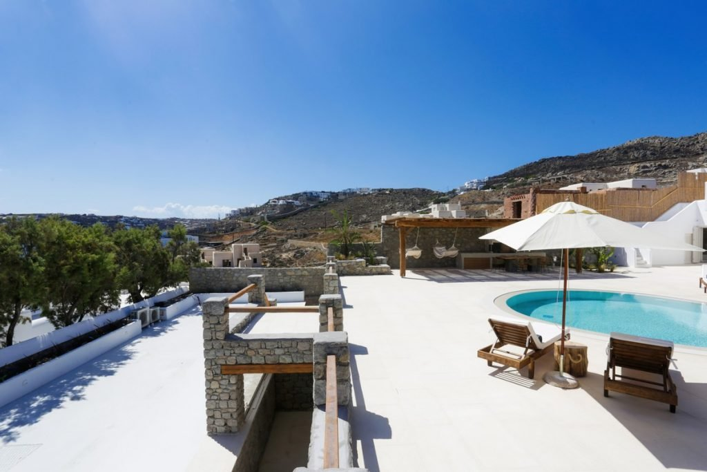 Villa Angelica Kanalia Mykonos outdoors pool and sunbeds with the panoramic view