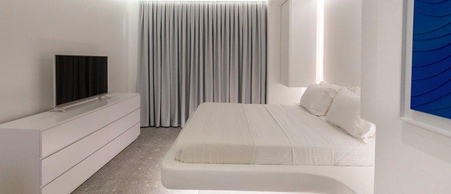 white walls of room with comfortable king size bed