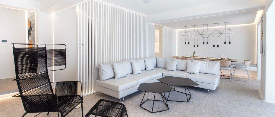 white walls of room with huge white sofa and decorative black chair